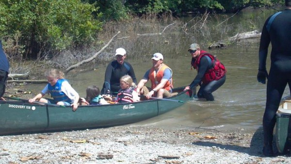 Dr. Laudie Canoeing with his daughter Adalynn and Kaitlynn